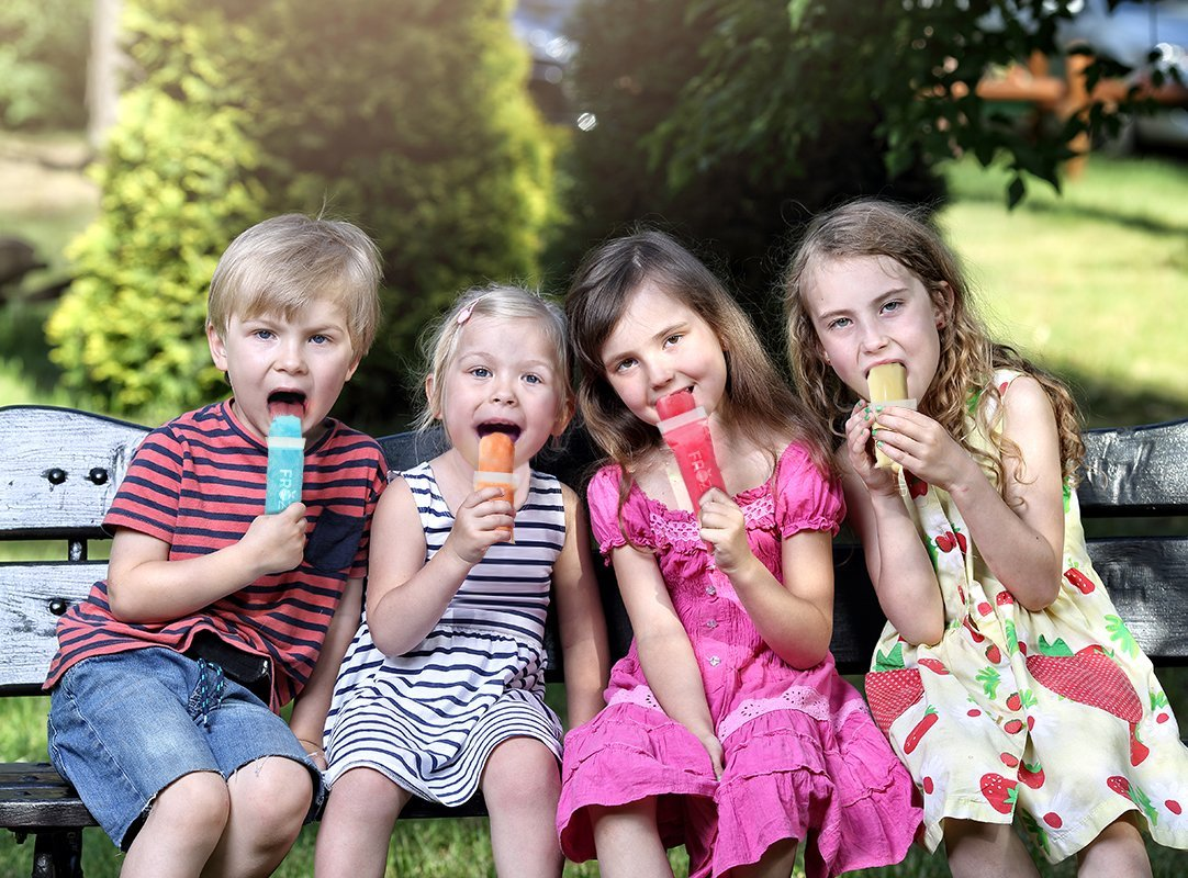 Kids eating frozip popsicles