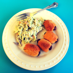 Cheddar pigs in blanket with broccoli slaw